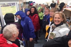 A-group-of-hardy-and-very-cheerful-American-visitors-huddle-in-the-site-shop-to-escape-the-monsoon-like-rain