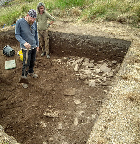 Trench supervisor Mike (left) and Marcus contemplate the spread of rubble found at the top of Trench Y.